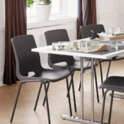 RBM Standard folding table. Polar White laminate tabletop. Ana, PP shell in 12930 Charcoal, legs in Grey.